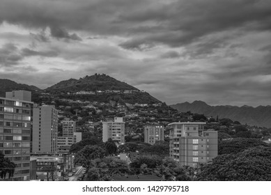 Honolulu, Hawaii, USA.  June 20, 2019.  Evening view of the Manoa Valley area with silver cumulus clouds above.