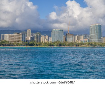 Honolulu, Hawaii, USA, June 26, 2017:  Late afternoon panorama of Waikiki skyscrapers and a construction crane in place to build a new high rise building.
