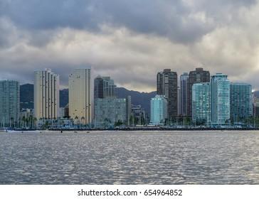 Honolulu, Hawaii, USA, June 6, 2017:  Dawn from offshore Waikiki as tropical rain clouds build overhead.