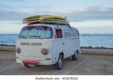 Honolulu, Hawaii, USA, June 8, 2016:  Old surfing van with vintage surfboards at Kaiser's Surfing Beach in Waikiki.