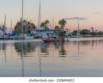 Honolulu, Hawaii, USA.  Mar. 4, 2019.  Dawn  Hawaiian outrigger canoe practice in the calm waters of the Ala Wai Small Boat Harbor.