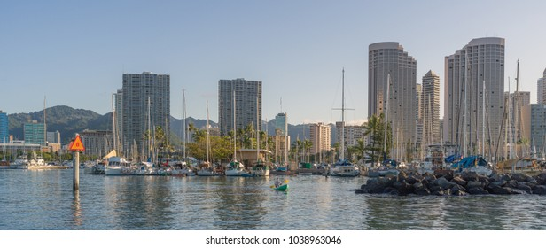 Honolulu, Hawaii, USA, March 5, 2018.  Sunrise on a spring morning in the Ala Wai Harbor as people begin their day in the water and tropical sunlight.