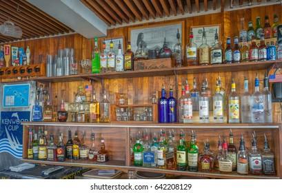 Honolulu, Hawaii, USA, May  18, 2017: Old Hawaiian Tiki Bar with vintage Koa wooden background  and  off the tourist trail in Waikiki.