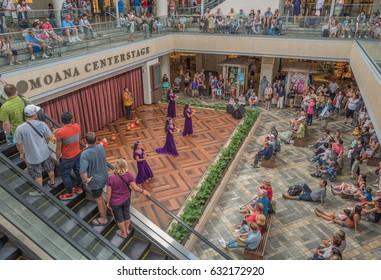 Honolulu, Hawaii, USA, May 2, 2017:  Hula dancers and shoppers enjoy the new expanded Ala Moana Shopping Center on a warm tropical morning.