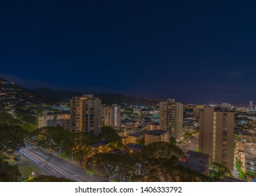 Honolulu, Hawaii, USA.  May 24, 2019.  Night time lapse above Manoa Hawaii with high rise condominiums around the University of Hawaii campus.