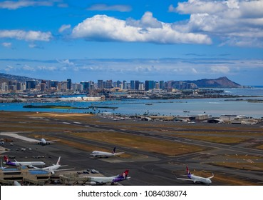 Honolulu, Hawaii, USA - May 25, 2015: Aerial view of downtown Honolulu, Diamond Head and airplanes on the field of Daniel K. Inouye International Airport (HNL), Honolulu International Airport