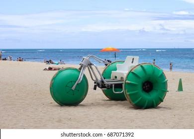 Honolulu, Hawaii, USA - May 25, 2016: Aqua-Cycle Water Trike for rent on Waikiki Beach.