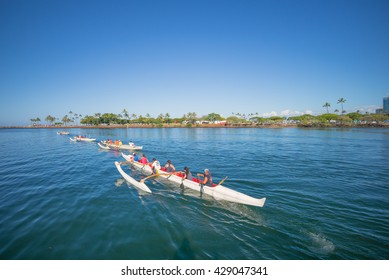 Honolulu, Hawaii, USA, May 31, 2016:  Morning view of a group of Hawaiian Outrigger Canoes and paddlers leaving the Ala Wai Channel for Waikiki.