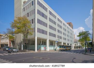 Honolulu, Hawaii, USA, May 9, 2016:  Morning view of art deco 1950's buildings on North King Street in downtown Honolulu.
