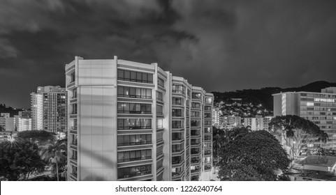 Honolulu, Hawaii, USA.  Nov. 10, 2018.  Time lapse view of Hawaii condominiums on a rainy night in Manoa.