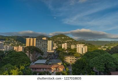 Honolulu, Hawaii, USA.  Nov. 12, 2018.  Manoa District evening as the Sun reflects off windows.
