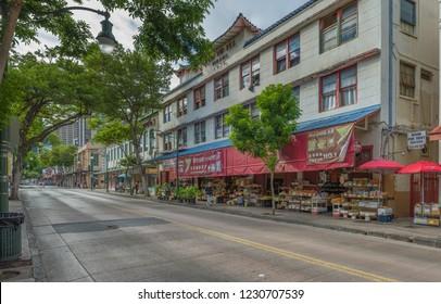 Honolulu, Hawaii, USA.  Nov. 15, 2018.  North Hotel Street panorama in Chinatown as early shoppers buy food.