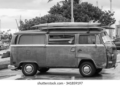 Honolulu, Hawaii, USA, Nov. 21, 2015:  Morning view of a vintage surfing van with surfboards.
