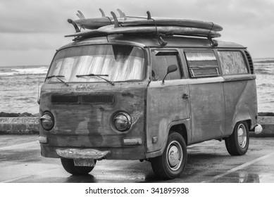 Honolulu, Hawaii, USA, Nov. 21, 2015: Morning  Waikiki view of an antique surf van in a rain shower.