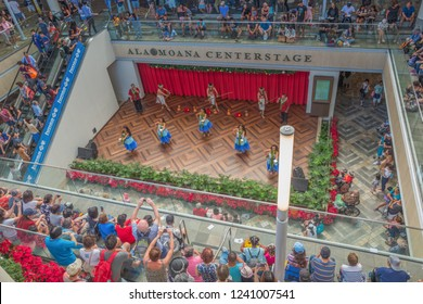 Honolulu Hawaii, USA.  Nov. 25, 2018.  Black Friday Christmas Shoppers crowd the expanded Ala Moana Shopping Center to shop and hear free music with a holiday theme.