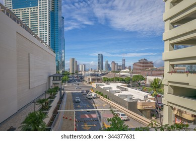 Honolulu, Hawaii, USA, Nov. 27, 2015:  Morning view of the new entrance to the Ala Moana Shopping Center with downtown Honolulu in the background.  Ala Moana is the largest mall in Hawaii.