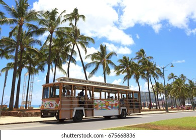 Honolulu, Hawaii, USA, November 31, 2017: Waikiki Trolley: A Waikiki Trolley stops on Kalakaua Ave. Waikiki Trolley is the favorite tourist transportation on Oahu.