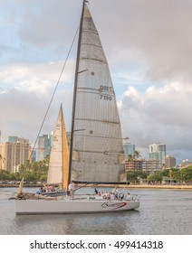 Honolulu, Hawaii, USA, Oct. 17, 2016:  Profile view of a racing sailboat and crew preparing for a race around Waikiki.