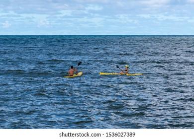 Honolulu, Hawaii, USA - Oct 21st 2018: Canoeing along the coastline of Honolulu Hawaii on a cloudy autumn day in October