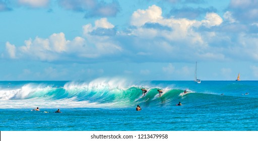 Honolulu, Hawaii, USA - October 21, 2018: Surfers at the Bowls Ala Moana surf spot capitalize on a south swell along Oahu's south facing shores.