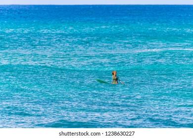 Honolulu, Hawaii, USA - October 28, 2018: Located near Waikiki, Oahu, Ala Moana Beach Park is notorious for its south town-side surf spots.