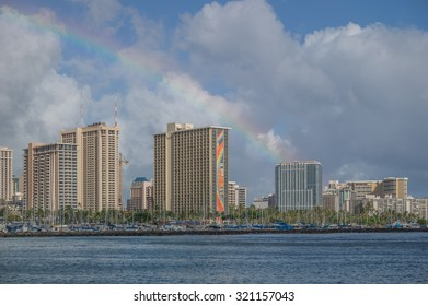 Honolulu, Hawaii, USA, Sept 27, 2015:  Afternoon view of the Hilton Rainbow Tower with a rainbow above.  Hilton Hawaiian Village is a favorite family vacation destination.