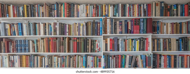 Honolulu, Hawaii, USA, Sept. 28, 2016:  Colorful panorama view of a library of books on white book shelves.