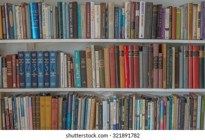 Honolulu, Hawaii, USA, Sept. 29, 2015:  Bookshelves containing colorful vintage books for use as background or for wallpaper.