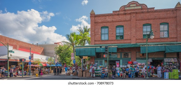 Honolulu, Hawaii, USA, Sept. 4, 2017:  Chinatown panorama of shoppers hunting for fresh fruits  and vegetables under warm tropical skies.