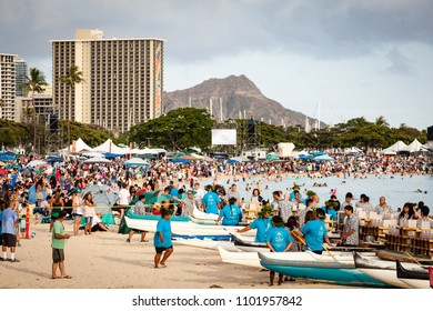 HONOLULU, HAWAII/USA – MAY 28, 2018: Lantern floating ceremony crowd at Ala Moana Beach Park on Magic Island in downtown Honolulu, Oahu, Hawaii, USA with Diamond Head in background.