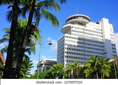HONOLULU, HI -12 DEC 2018- View of the Waikiki Business Plaza, a modern mixed use building with a revolving restaurant on top, located on Kalakaua Avenue in Honolulu, Oahu, Hawaii.