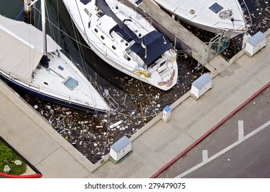 HONOLULU, HI: FEB 2012: garbage floats in the water in a harbor on February 17, 2012.   Water Pollution is damaging not only to individual species and natural biological communities.