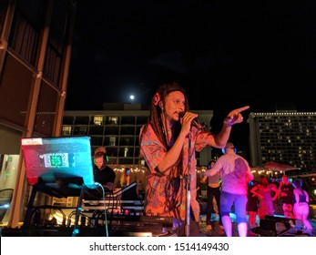 Honolulu, HI - January 4, 2019: DJ Jerome James and Full Moon at Silent Disco on rooftop deck.