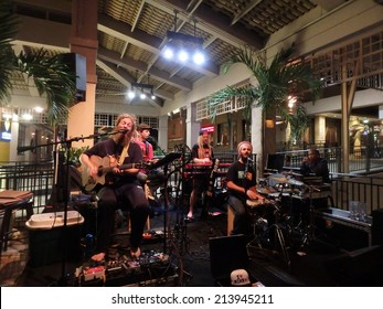 HONOLULU, HI - JULY 30: Band Mike Love Jams at Mai Tai Bar in Ala Moana Shopping Center on July 30 2014, Honolulu, Hawaii.