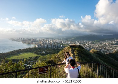 Honolulu, HI: September 27, 2016: Tourists taking pictures at the Diamond Head hiking trail.  Diamond Head is a popular hiking trail in Hawaii.