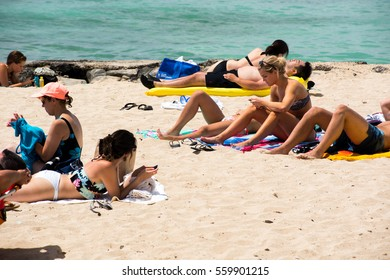 Honolulu, HI: September 27, 2016: People enjoying the beach in Waikiki.