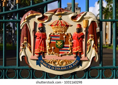 Honolulu, HI, USA August 1, 2014 The Crest of the Kamehameha royal family hangs on an iron fence surrounding at Iolani Palace in Honolulu, Hawaii.  It is said to be the only royal palace in the USA