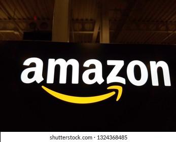 Honolulu - January 12, 2017:  Amazon logo on black shiny wall in Honolulu Best Buy store on January 12, 2017.  Amazon is an American international electronic commerce company.