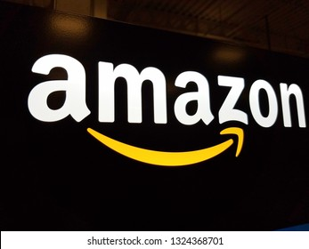 Honolulu - January 12, 2017:  Amazon logo on black shiny wall in Honolulu Best Buy store on January 12, 2017.  Amazon is an American international electronic commerce company.