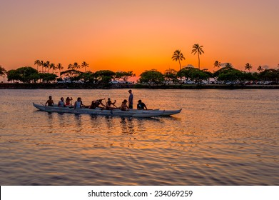 Honolulu, July 20, 2014:  Outrigger Canoe Paddlers listen to their coach as they prepare for the Hawaii State Canoe Championships, Honolulu, Hawaii, USA.  July 20, 2014