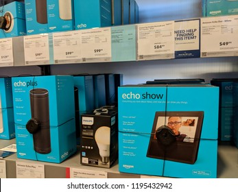 Honolulu - July 8, 2018:  Echo Show, Phillips Hue and Echo Plus on Display at Best Buy.  Amazon Echo Show and Spot is a smart speaker that is part of the Amazon Echo line of products.