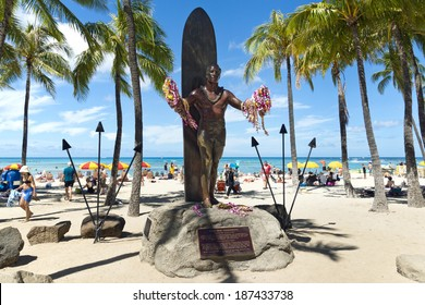 HONOLULU - JUNE 15: Duke Kahanamoku statue holding leis at Waikiki Beach on June 15, 2013. Duke is is remembered as the greatest waterman who ever lived, and Hawaiis ambassador of Aloha.