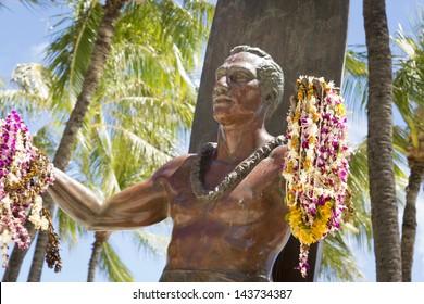 HONOLULU - JUNE 15:Duke Kahanamoku statue holding leis at Waikiki Beach on June 15, 2013.  Duke is is remembered as the greatest waterman who ever lived, and Hawaii'Â?Â?s ambassador of Aloha.
