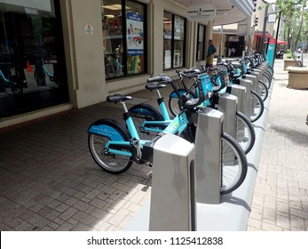 Honolulu - June 29, 2017: Row of Biki Bikeshare on Fort Street Mall in front of Fisher Hawaii.  Biki is Honolulu's new transportation system, brought to you by Bikeshare Hawaii.