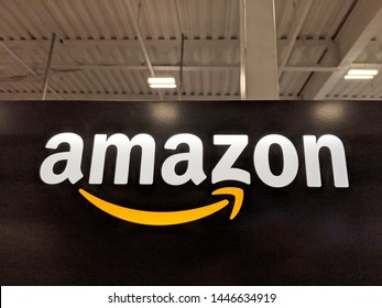 Honolulu -  March 16, 2019:  Amazon logo on black shiny wall in Honolulu Best Buy store.  Amazon is an American international electronic commerce company. It is the world's largest online retailer.