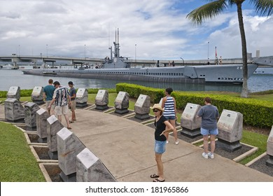 HONOLULU - MARCH 30, 2012: The USS Bowfin next to the USS Arizona Memorial on Oahu, Hawaii.  The Bowfin has been open to public tours since 1981.