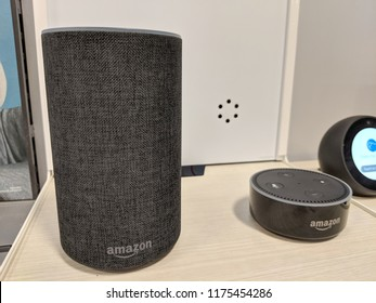 Honolulu - March 7, 2018: Echo and Echo Dot (2nd Generation) - Smart speaker with Alexa - Black on display.  It is designed around Amazon's virtual assistant Alexa.
