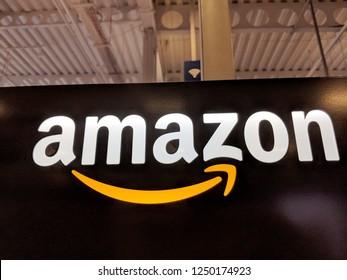Honolulu - May 29, 2018:  Amazon logo on black shiny wall in Honolulu Best Buy store.  Amazon is an American international electronic commerce company. It is the world's largest online retailer.