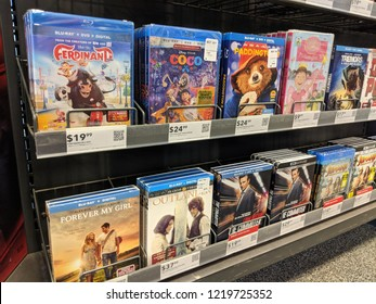 Honolulu - May 29, 2018:  Rows of Blu-Ray on display at Best Buy featuring movies Ferdinand, Coco, Paddington, tremors, Jumanji,  Outlander, Forever My Girl and the Commuter.