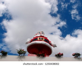 Honolulu - November 13, 2013:  Santa on top of Ala Moana Mall.  Every year Ala Moana Mall places a large Santa Claus on top of parking garage to celebrate Christmas in Hawaii.